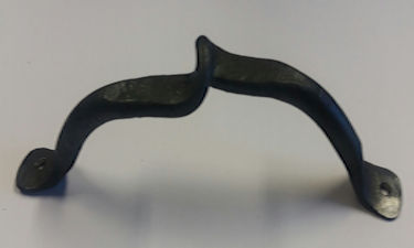Wrought iron farmhouse kitchen cupboard handle with decorative wave detail