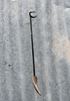 Hand forged pigtail meat turner with antler handle