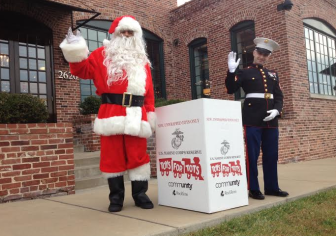 Santa and a US Marine help kick off Toys for Tots in Maplewood.