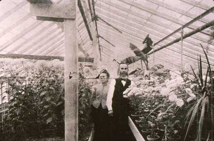 Mr. Stertzing and wife in the greenhouse that was once attached to their building.