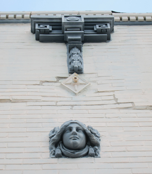 Some interesting terra cotta details on this building.