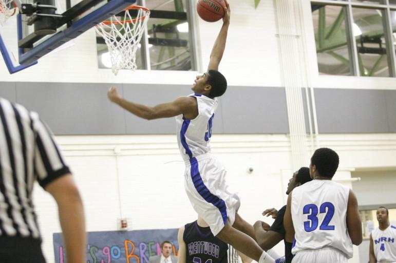 MRH junior Chris Blocker goes up for a dunk against Brentwood.
