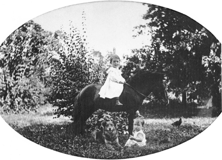 Charles Cartmell, age 2 1/2 and M. Warder, age 1 with their pony and dog who shall remain nameless.  No doubt named after