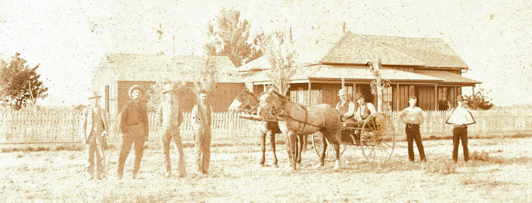 """On back, """"Edd. W. Rannells"""".  Date and location unknown.  Edward is in the wagon holding the reins I was told."""