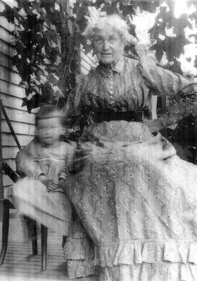 Mammy and Cartmell on the porch at Woodside.