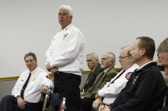 Richmond Heights Fire Chief Kerry Hogan speaks in favor of ECDC. Maplewood Fire Chief Terry Merrell (right) also came to support it, along with other area city fire  and police chiefs.