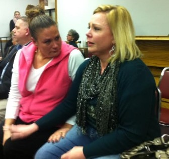 Brentwood dispatcher Judy Coleman is consoled by friend, Lisa Beckman after the vote.