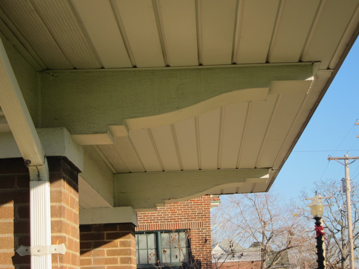These large graceful brackets will look so much better once the aluminum soffit is removed and an original style of soffit most likely made of bead board is installed.