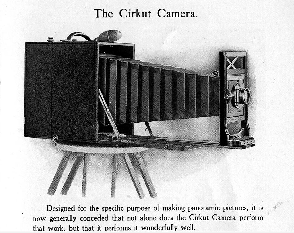 This image I pulled from a reproduced manual I found on the internet.  this is very likely the kind of camera that made the image.  it contained a clockwork mechanism that when wound and released using a gear in the top of the tripod simultaneously rotated the entire camera and as it wound the roll of film past the aperture.  the result was amazingly sharp photos.