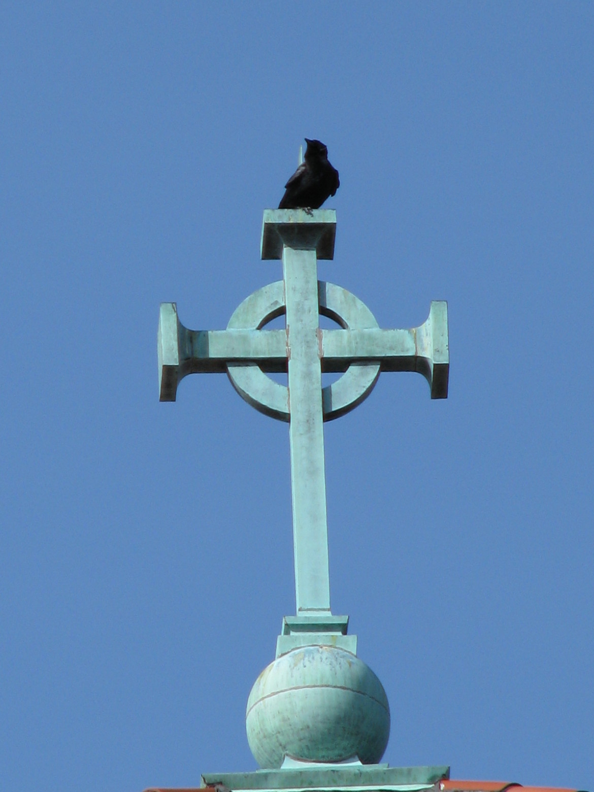 A seat on top of the copper cross must certainly afford a good view.