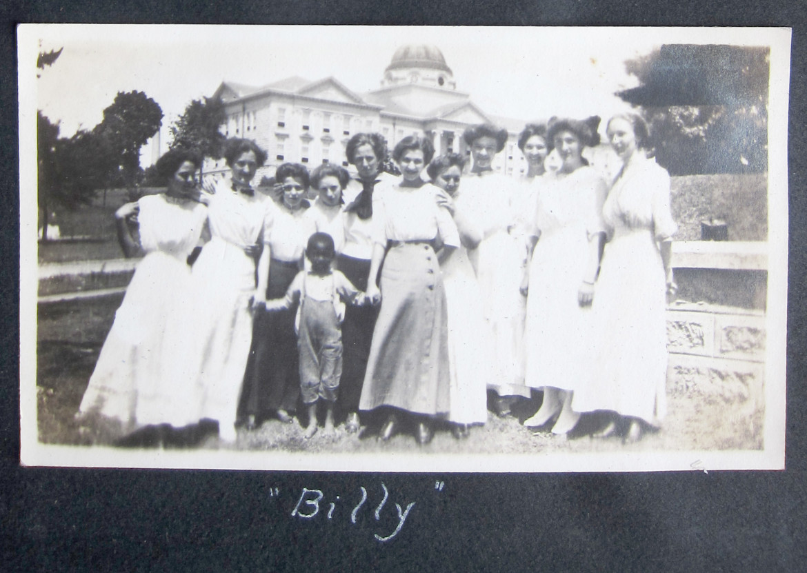 This image was made on the campus of the state university at Cape Girardeau.  I haven't any idea what they are up to.  Most of the women in these photos on campus are wearing all white dresses.