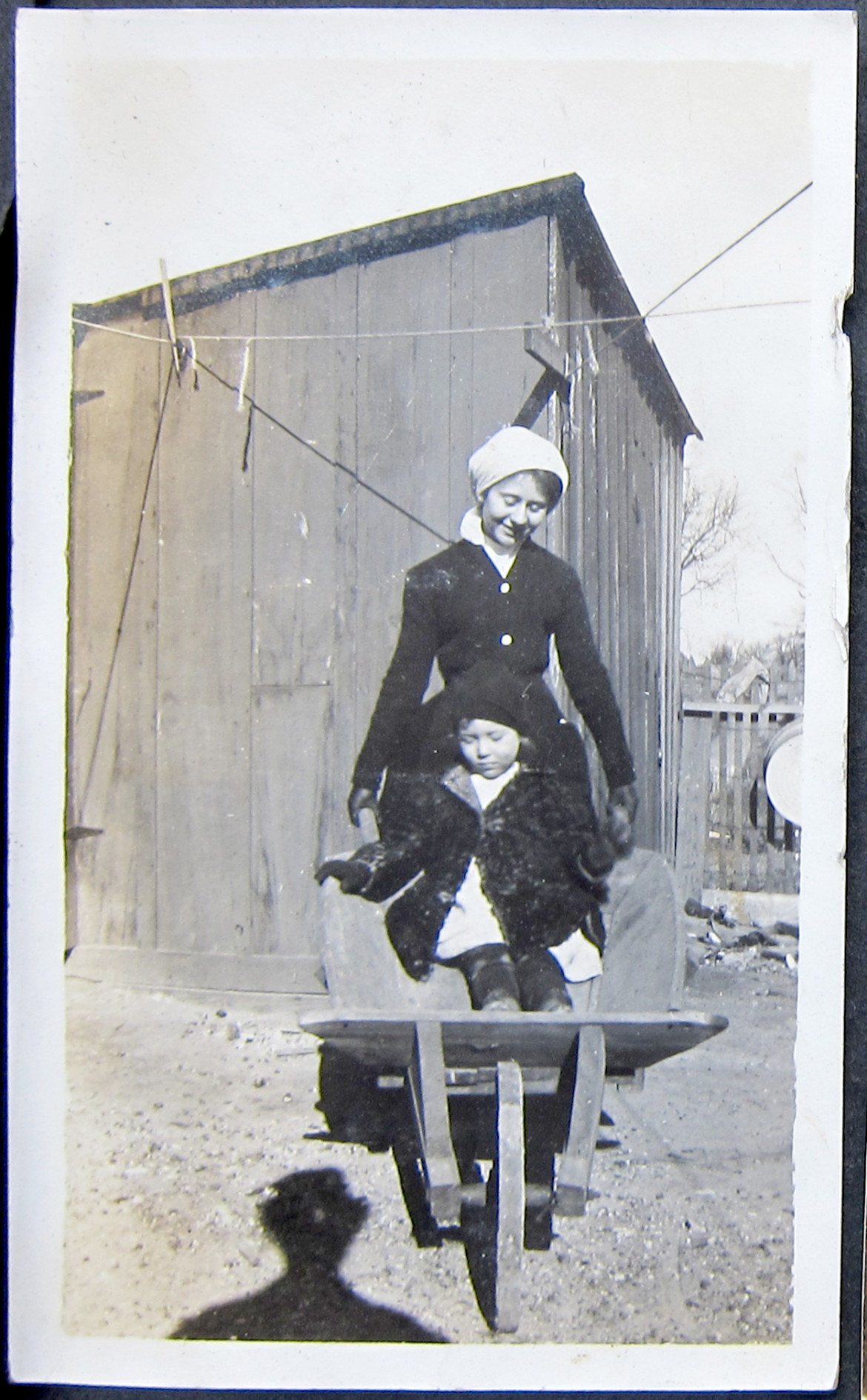 Amongst the Irwin collection are scenes from possibly two family farms.  These first four images are on the pages that contain photos from Talitha's pre marital life.  Here we have an unidentified woman wheelbarrowing an unidentified child.  the only thing I can say for sure is that is a wheel barrow.