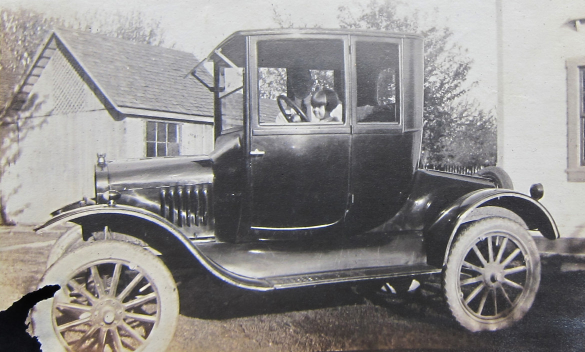 Let's start with one of my favorites, the family car.  I believe Marjorie is at the wheel with her father, albert beside her.  She was born in 1918 so that should give us an idea of the year of this photo.  1920?  The location is unknown.