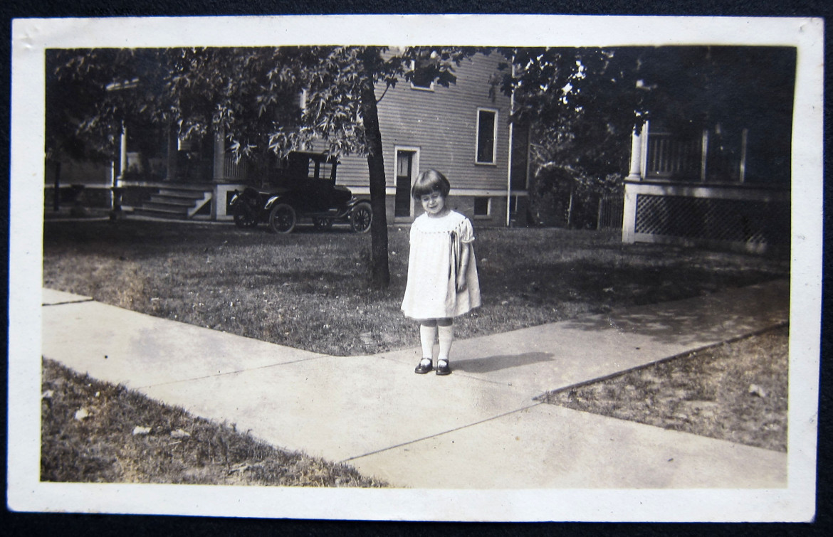 Here's Marjorie in front of their home at 2855 Laclede Station Road.