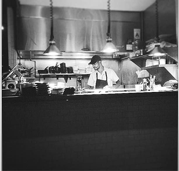 Matthew Daughaday at work in the kitchen.