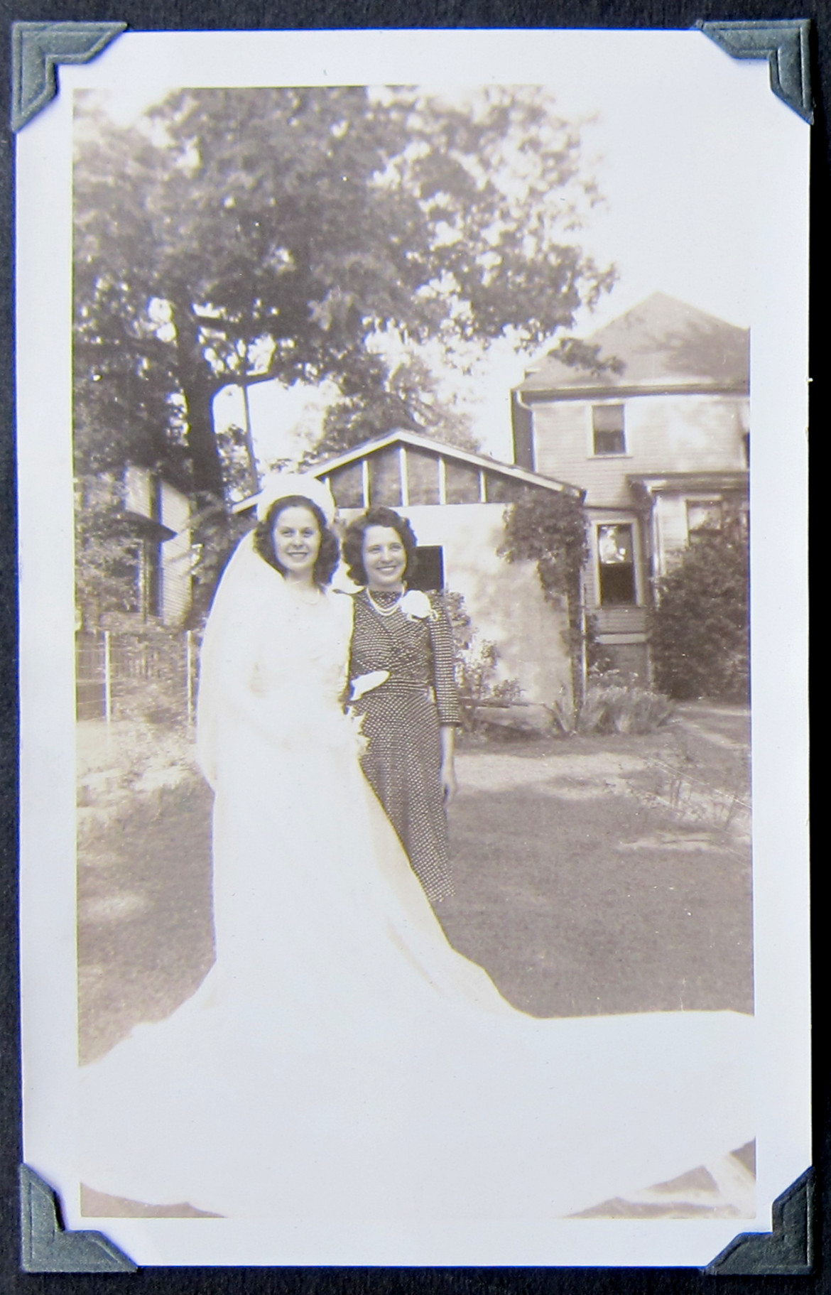 well, one thing leads to another.  Marjorie and a friend in the back yard of her home at 2855 Laclede Station Road.