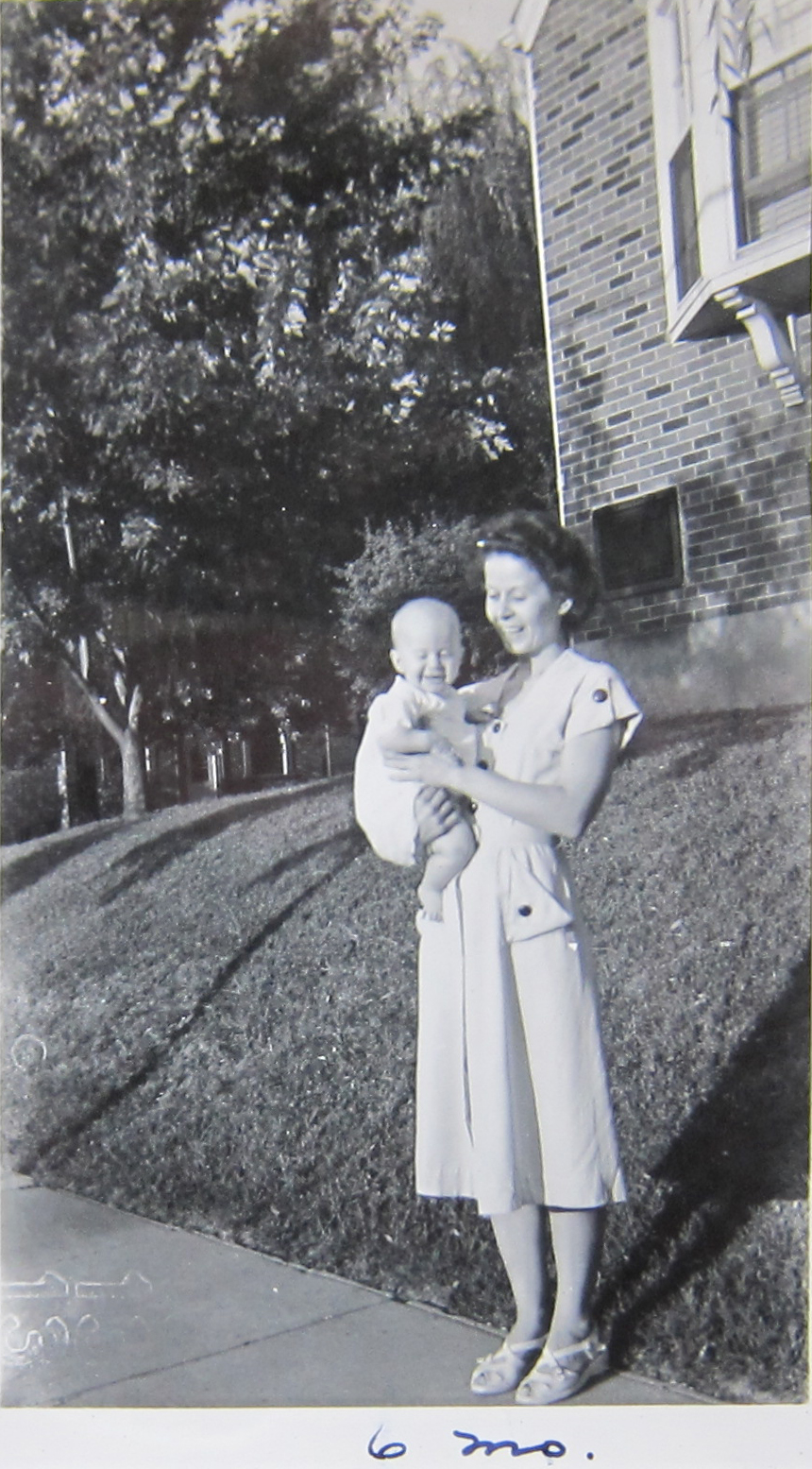 I believe this photograph was taken in front of the duplex or multi-family home where Bob and Marjorie lived after they married.