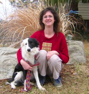 Dorene Olson with another border collie, Merlin, a therapy dog.