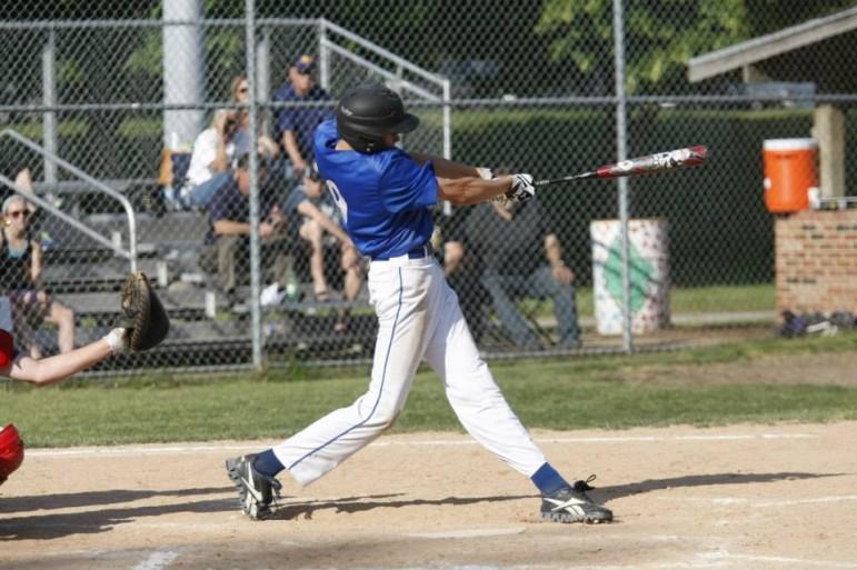 Chris Tronicek swings the bat in last year's district final.
