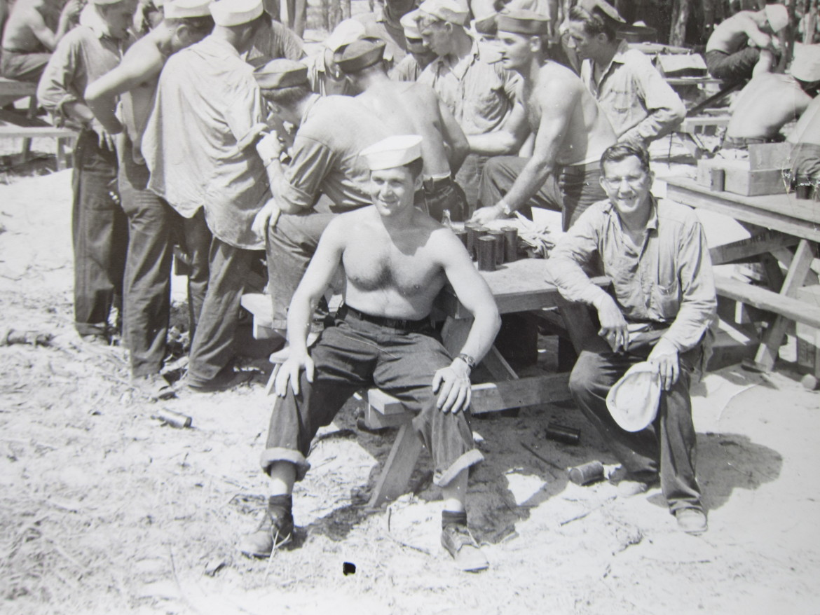 Syl is seated on the right somewhere in the south Pacific during WWII.