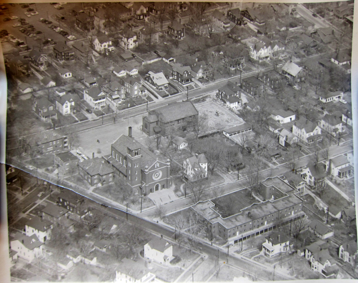 An aerial view of  the Maplewood church of the Immaculate Conception.  Taken by Syl with a Graflex Camera from their Funk aircraft.