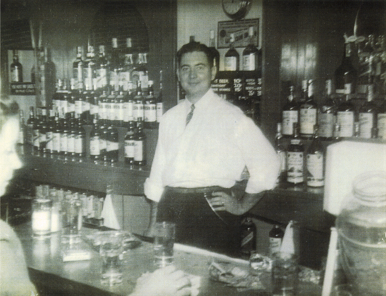 One more of Mr. Hugo with his impressive inventory of spirits.