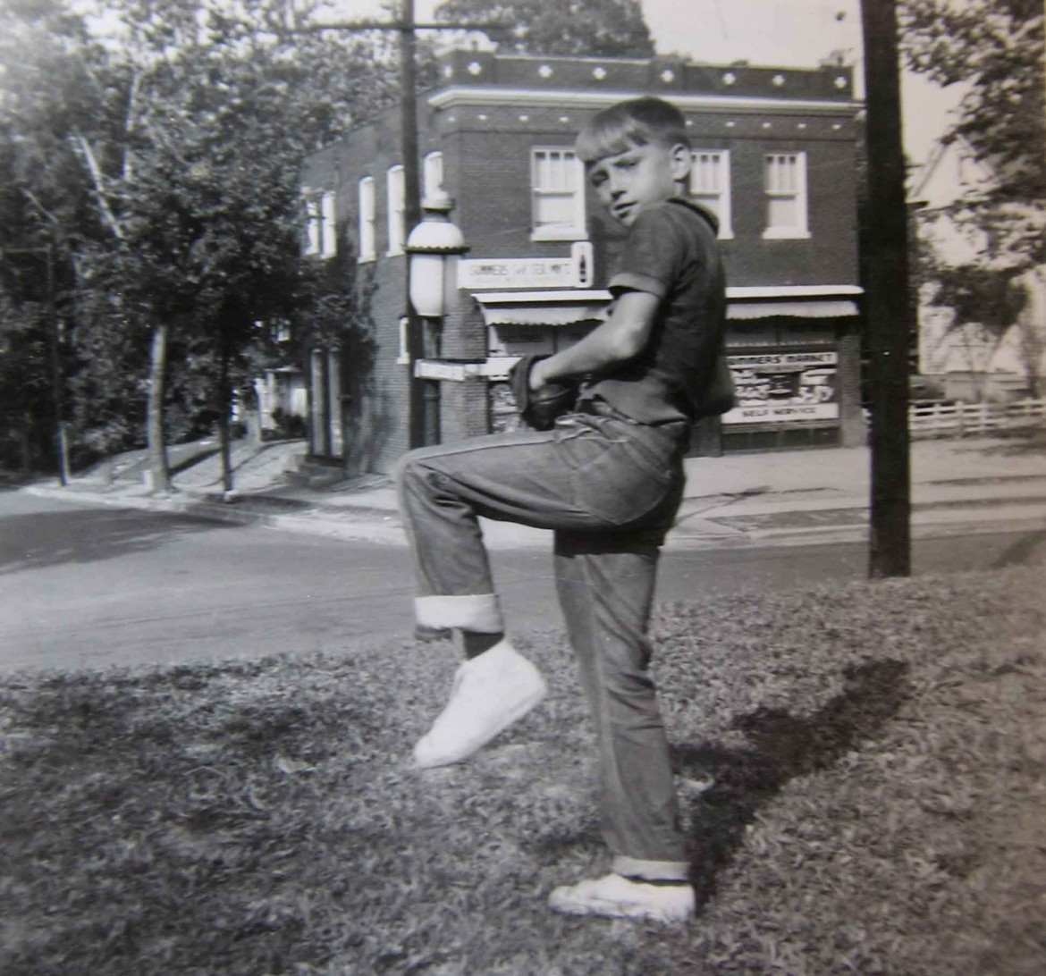Let's start with this photo because it has a good view of the building. The young man, probably a neighbor, is Chester Rose and the year is 1955.