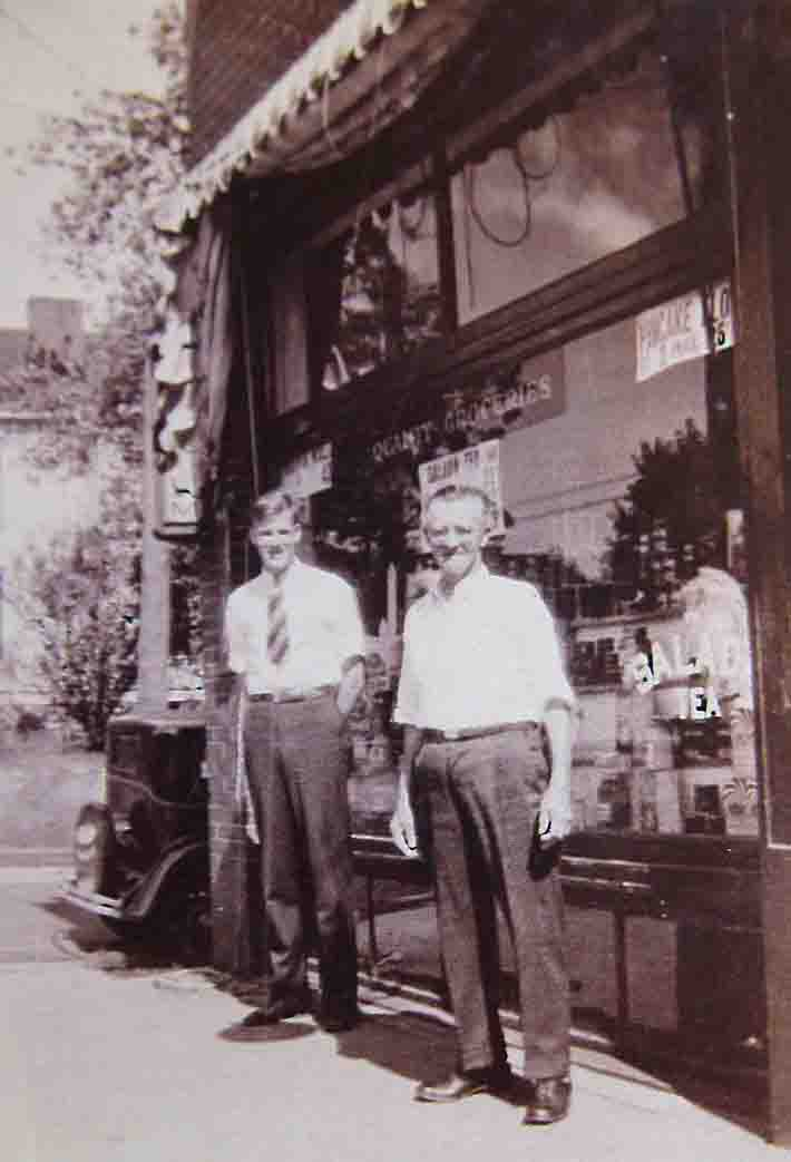 An undated image of Martin Fellhauer now considerably oder and John D. O'Brien in front of the store. The car is early 1930's.