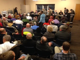 Residents and the city council gather for the meeting Tuesday evening.
