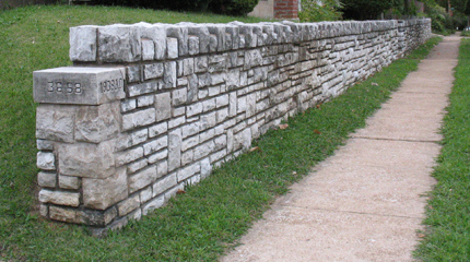This a sturdy stone wall you might encounter if you take a stroll through the Greenwood neighborhood. Doug Houser photo.