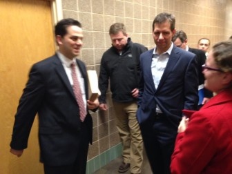"""A resident congratulates developer Joe Cyr, after the meeting, while another said, """"Don't mess it up, Joe."""""""