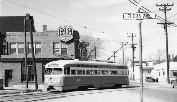 In this photo which I found on a Facebook page called Vintage St. Louis, a streetcar passes in front of a restaurant and bar called Ted's Corner. The beginning of the wall in the previous two photos can be seen at the left.