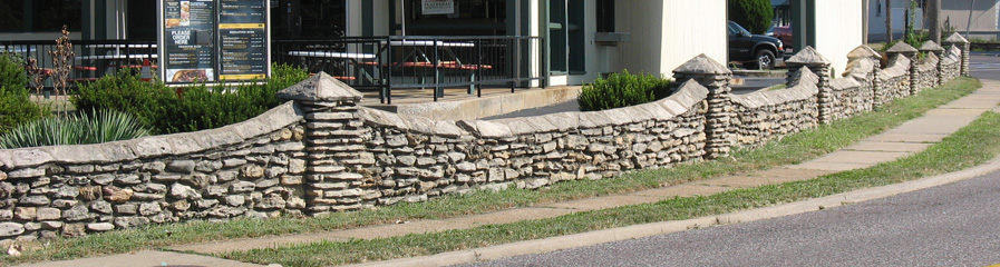 Most Maplewoodians are familiar with and appreciate this stone wall that is on Flora just west of Big Bend. The wall is rubble of course. The flat stones used for the top of the wall (called coping) and in the squat columns I have heard referred to as flagstones.