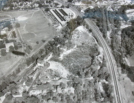 An aerial view of the quarry with Big Bend Road running along the top edge. The factory at the top center is still there. Once Sefton Can Co. it is now owned by Sunnen, I believe. Courtesy of the Maplewood Public Library.