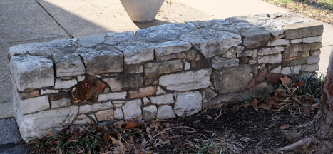 This is one of a pair of free form stone walls, bench height, on Oxford at Kensington. They were comissioned by the late Bece Fossey, former owner of the property and principal of the sutton Studio architectural firm. Bece was a wonderful gal and left way too soon. I beleive either her brother or son created this stonework.