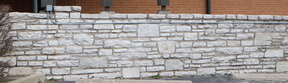 This is one of a lovely pair of stone walls that flank either side of the J.B.Smith Funeral Parlor AKA the Sarah Sutton Harrison historic home at 7456 Manchester.