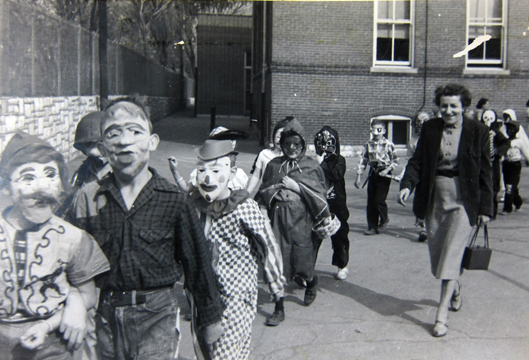 Halloween at the Sutton School with the stone wal visible in the background. courtesy of Evelyn Detert and the American Legion hall.