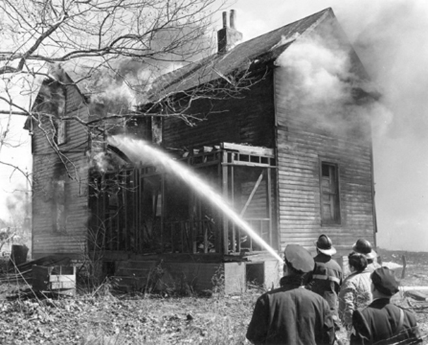"We can't say what happened to all of the homes but we know what happened to this one. Called ""a practice burn at Luda and Wall Ave."" Courtesy of the Maplewood Public Library."