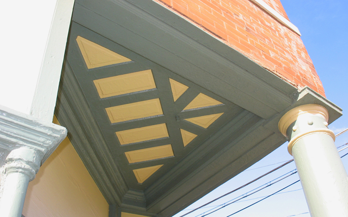A super cool triangular paneled ceiling on the corner entry.