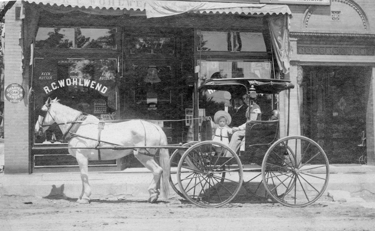 Opened in 1907 this photo is of Emil and Rosa with their son, emil c. in front of their first hardware store in the 7200 block of Manchester. The name of their horse was not recorded. Courtesy of Jessica Ernst.