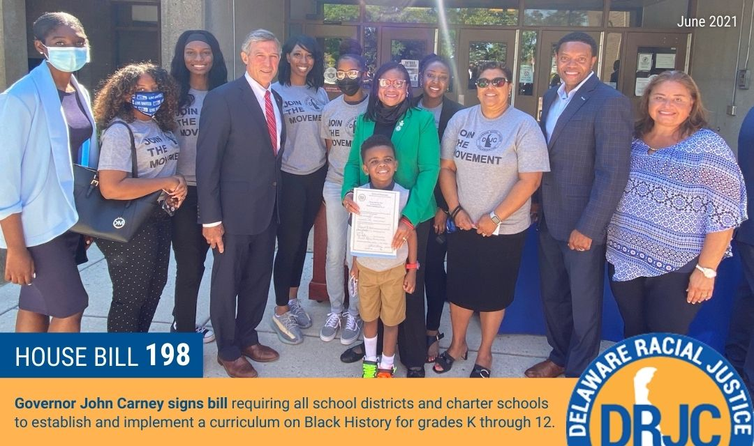 Governor Carney signs House Bill 198 with United Way of Delaware & Delaware Racial Justice Collaborative in Wilmington, Delaware