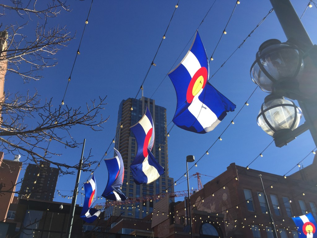Larimer Square with Colorado flags. Denver Urban Review