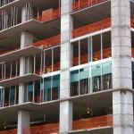 Glass installation begins at SkyHouse Denver