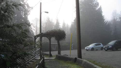 Looking across the parking lot, at Manson's hall on Cortes Island, towards CKTZ