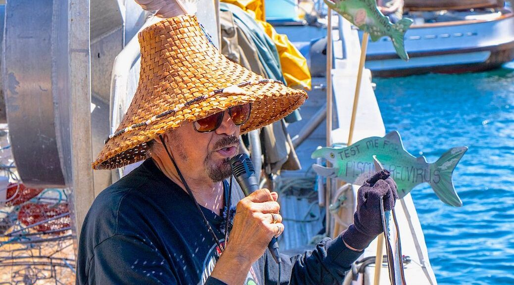 Hereditary Chief George Quocksister Jr. speaks at a protest flotilla at a Discovery Islands salmon farm in May calling on DFO to refuse permission to restock sites in the region.