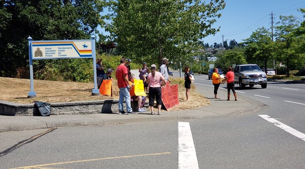 Freinds and family demonstrating in fron t of the Campbell River RCMP office after Jared Lowndres death