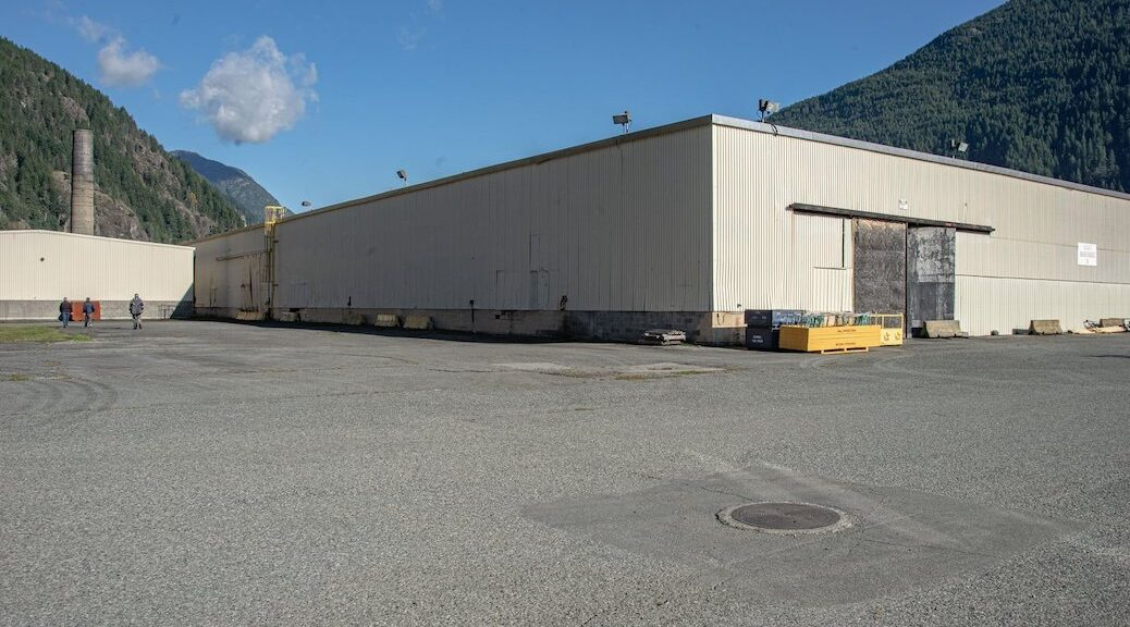A large warehouseon a parking lot