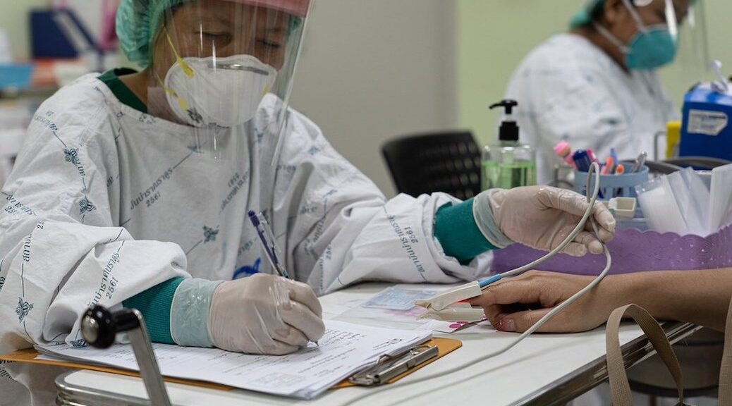 Two Asian women working in a lab