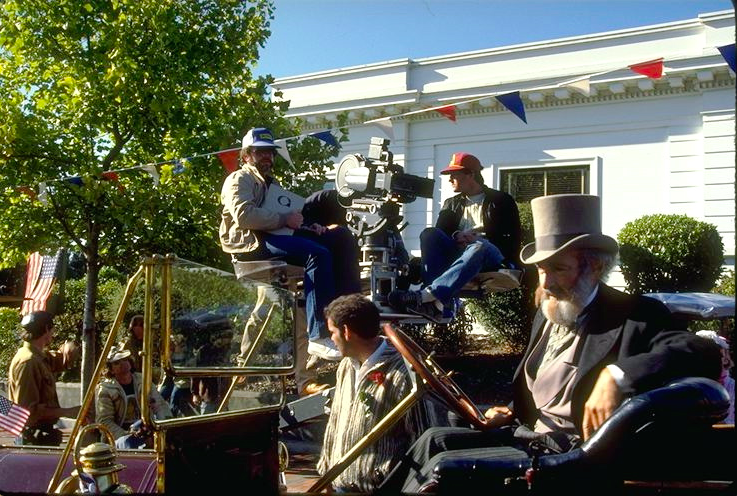 Gary Goddard behind the camera as the crew prepares to shoot the massive finale parade on location in Eureka, California.  Phineas T. Flagg prepares for this close up in the foreground. Copyright The Goddard Group All Rights Reserved