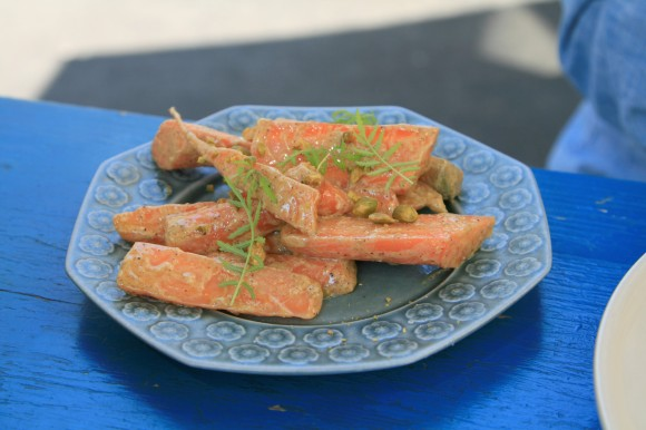 carrots with pralines, pistachios and marigold